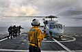 US Navy 100327-N-4774B-157 Boatswain's Mate 3rd Class Alexander Black, from Quinlin, Texas, directs an SH-60F Sea Hawk helicopter assigned to the Red Lions of Helicopter Anti-submarine Squadron (HS) 15.jpg