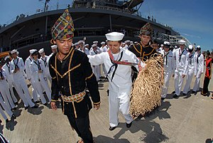 Kadazan people -  Malaysian dancers teaching Sailors assigned to the U.S. 7th Fleet command ship USS Blue Ridge (LCC 19) on how to perform the traditional Malaysian Kadazan dance upon the arrival in Sepangar, Malaysia, 2010.