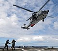 US Navy 100622-N-7058E-515 Naval aircrewmen assigned to Helicopter Sea Combat Squadron (HSC) 22 transfer a simulated casualty from the littoral combat ship USS Freedom (LCS 1) to an MH-60S Sea Hawk helicopter.jpg