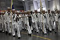 US Navy 100627-O-6890K-002 Sea Cadets assigned to Division 003 presents arms to the official party at USS Midway Ceremonial Drill Hall at Recruit Training Command.jpg