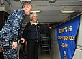 US Navy 100715-N-5658B-023 Command Chaplain Cmdr. Cameron Fish and former First Lady Barbara Bush tour the ship's library aboard the aircraft carrier George H.W. Bush (CVN 77).jpg