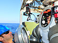 US Navy 101026-N-8824M-092 Navy Diver 2nd Class Dylan Oursler removes the vision dome from the Atmospheric Diving Suit 2000 of Navy Diver 2nd Class.jpg
