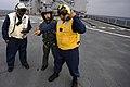 US Navy 101207-N-8335D-526 A Japan Maritime Self-Defense Force sailor speaks with U.S. Navy Sailors aboard the amphibious dock landing ship USS Tor.jpg