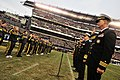 US Navy 101211-N-8273J-292 Chief of Naval Operations (CNO) Adm. Gary Roughead, second to the right, administers the oath of enlistment to recruits.jpg