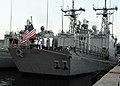 US Navy 110501-N-NL541-227 The color guard of the guided-missile frigate USS Boone (FFG 28) lowers the national ensign during evening colors.jpg