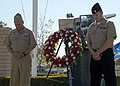 US Navy 110603-N-HW158-025 Rear Adm. Mathias W. Winter and Culinary Specialist 2nd Class Richard Coggins bow their heads for a moment of silence du.jpg