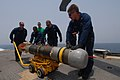 US Navy 110715-N-DU438-039 Sailors guide a MK-46 torpedo during an ammunition transfer aboard the guided-missile cruiser USS Gettysburg (CG 64).jpg