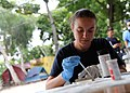 US Navy 110818-F-ET173-295 Hospital Corpsman 2nd Class Raquel Loudermilk, from Seville, Spain, conducts a urinalysis at the Killick Haitian Coast G.jpg