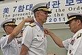 US Navy 110825-N-CZ945-001 Republic of Korea navy Chief of Naval Operations Adm. Kim Sung-chan, right, presents the Republic of Korea Order of Nati.jpg