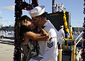 US Navy 110930-N-UK333-097 Electronics Technician 1st Class James Bowler is kissed by his wife as he is the first to disembark from the Los Angeles.jpg