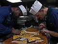US Navy 111108-N-KA046-010 Sailors decorate a cake for the Marine Corps birthday celebration aboard the amphibious dock landing ship USS Whidbey Is.jpg