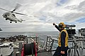US Navy 111123-N-ER662-409 Boatswain's Mate 2nd Class Lonnie Hill directs an SA-330J Puma helicopter as it delivers a palette of supplies.jpg