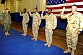 US Navy 111123-N-IA861-057 Adm. Mark Ferguson, Vice Chief of Naval Operations, reenlists four Sailors during a visit to Naval Support Activity, Bah.jpg