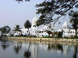 Ujjayanta Palace as seen from the Rajbari Lakes.jpg