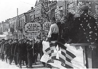Ribbon of Saint George - Members of the collaborationist anti-Soviet Union of Russian Youth use the Ribbon of Saint George at a demonstration in Babruysk (today Belarus), 1943
