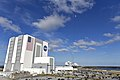 VAB with Falcon Heavy taking off in the background 01.jpg