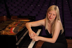 Valentina Lisitsa beside a piano