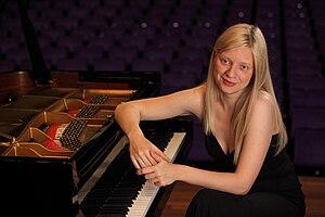 Valentina Lisitsa beside a piano
