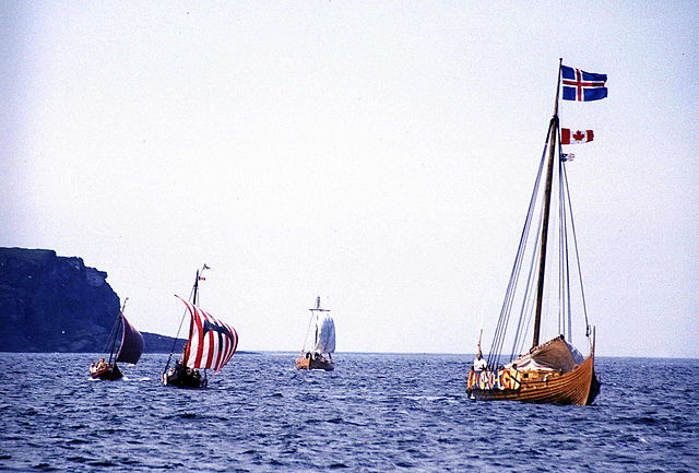 Reenactment of the Viking landing at L'Anse aux Meadows, Newfoundland, Canada, 2000. The foremost longship is flying, from top to bottom, the flag of Iceland, the flag of Canada, and the flag of Newfoundland and Labrador., credit Joyce Hill