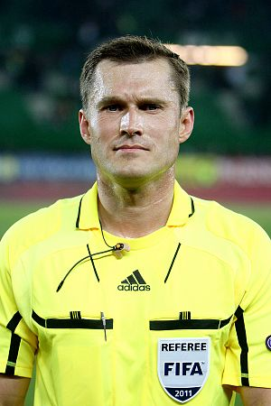 FIFA International Referees List - FIFA International Referee Vladislav Bezborodov wearing his referee's shirt with a 2011 FIFA badge