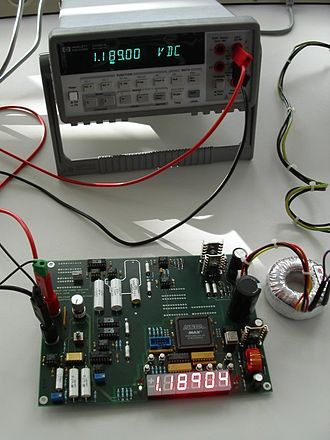 Electronic test equipment - Agilent commercial digital voltmeter checking a prototype