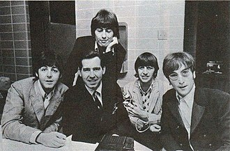 Sgt. Pepper's Lonely Hearts Club Band - The group, with disc jockey Jim Stagg, while on their final tour in August 1966