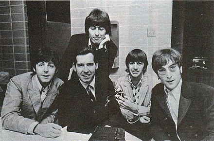 The group, with disc jockey Jim Stagg, while on their final tour in August 1966 WCFL Sound 10 survey October 1966 Beatles Jim Stagg (cropped).jpg
