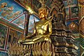 Wat Phnom- Buddha in the Central shrine (14064735240).jpg
