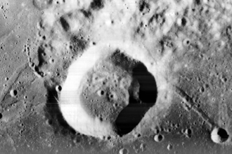 Lunar craters - Webb crater, as seen from Lunar Orbiter 1. Several smaller craters can be seen in and around Webb crater.