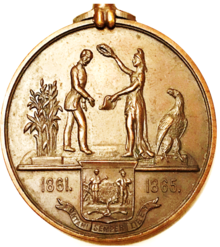 circular medal with grain, two people, an eagle, and dates