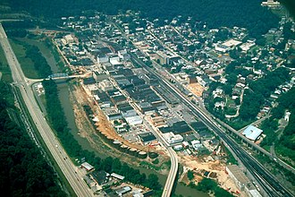 Williamson, West Virginia - Aerial view of Williamson, West Virginia, during construction of its current floodwall, completed in 1991. The Tug Fork river is the border between West Virginia and Kentucky; the highway on the left (US-119) is in Kentucky.