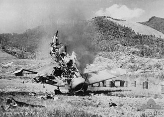 Battle of Wau - A Wirraway of No. 4 Squadron RAAF burns after being set on fire during the Japanese air raid on Wau.