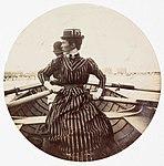 Woman in a rowing boat (2780164539).jpg