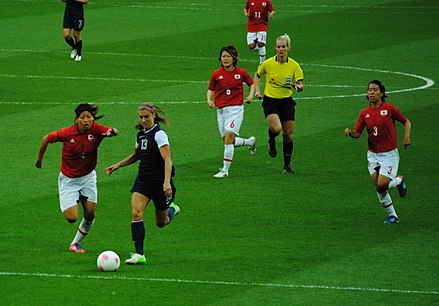 Morgan challenges Japanese defender Saki Kumagai for the ball as Mizuho Sakaguchi (6) and Azusa Iwashimizu (3) look on during their gold medal match at the 2012 Summer Olympics Women's Soccer - USA vs Japan (1).jpg