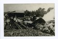 Wreck at P.B.S.I. July 13, 1910 (train wreck with men sitting on tracks and on overturned train) (NYPL b15279351-105161).tiff