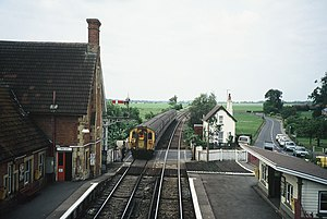 Ashford to Ramsgate line - Class 411 1619 with a 4-car set in Jaffa Cake livery leaves Wye station in 1989