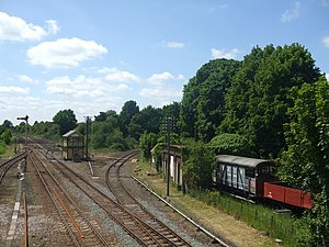 Wymondham railway station - The local signal box, Mid Norfolk Railway line to the right, and old rolling stock! pictured in 2009