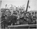 """U.S. Army nurses, newly arrived, line the rail of their vessel as it pulls into port of Greenock, Scotland, in European - NARA - 531204.tif"