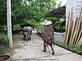 水牛和蓑衣 buffalos and the rain cloak - panoramio.jpg