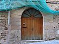 026 Palau Prioral (Monistrol de Montserrat), façana c. del Pont, portal adovellat.JPG