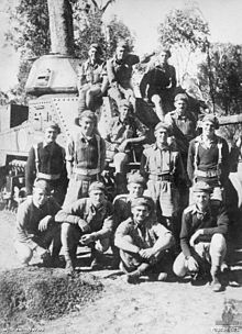 Members of the 2/7th Armoured Regiment with a M3 Grant tank