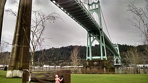 """(Up A) Lazy River - Permanent outdoor exhibit of a metal river at Cathedral Park, under the St. John's Bridge in Portland Oregon, installed with music box tune of Hoagy Carmichael's """"Up A Lazy River"""", the year the bridge was dedicated."""