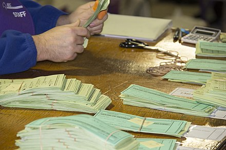 Polling official counting and bundling lower house ballot papers AEC-HoR-counting-3.jpg