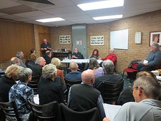 Voluntary association - An annual general meeting of a typical small volunteer non-profit organisation (the Monaro Folk Society). Office bearers sitting are president, secretary and public officer.