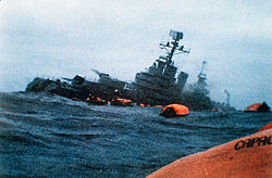 The Belgrano sinking after being struck by torpedoes fired by HMS Conqueror