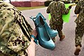 "A Sailor carries a pair of shoes as she participates in a ""Walk a Mile in Their Shoes"". (39909397070).jpg"