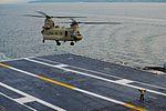 A Sailor directs a CH-47 Chinook for landing aboard USS John C. Stennis. (31411640740).jpg