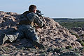 A U.S. Airman with the 90th Security Forces Group Tactical Response Force takes aim at simulated opposition forces occupying a 90th Missile Wing launch facility near Bushnell, Neb., during a recapture exercise 130517-F-JW079-031.jpg