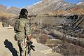 A U.S. Army Special Forces Soldier assigned to Combined Joint Special Operations Task Force-Afghanistan looks over the valley as a patrol returns from clearing compounds during an operation in Ghorband district 140115-A-CL980-248.jpg