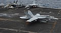 A U.S. Navy F-A-18E Super Hornet aircraft assigned to Strike Fighter Squadron (VFA) 147 lands aboard the aircraft carrier USS Nimitz (CVN 68) in the Indian Ocean June 7, 2013 130607-N-TW634-250.jpg